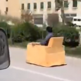 Motorized Couch on highway. This Sofa Car is great fun on road. Chinese man gives us an invention so we never have to get off the sofa… the Armchair Car!