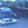 Shocking CCTV footage captures the moment a freight truck pushes a car 500 metres down a busy road in China.