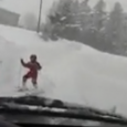 While driving down a snowy street, this dashcam catches a car narrowly hitting two kids who happened to be skiing on the road.