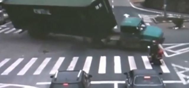 Luckiest Scooter Driver Ever! A man on a scooter has narrowly escaped being crushed by a massive truck.
