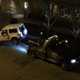 Jeep Driver Escapes Tow Truck In Chicago. Driver was not pleased when a tow truck driver tried to impound his car.