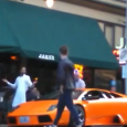 Guy jumps over a stranger's Lamborghini with his bike.