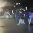 Dramatic moment hero cops pulled unconscious man from his burning car caught on dashcam. Police save man from certain death in car fire.