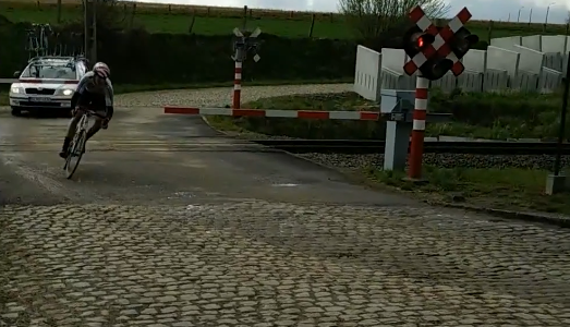 A group of riders going through a closed barrier at a railway crossing during the Ronde van Vlaanderen Beloften in Belgium. A rider was among several to ignore the closed […]