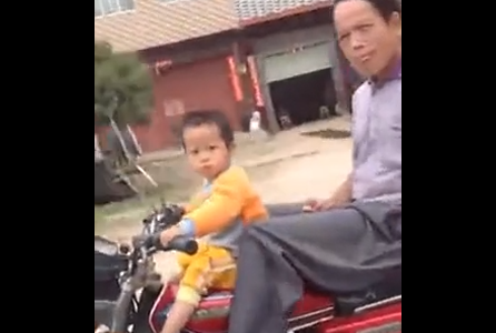 Little kid riding motorcycle in China. 2 yr old riding Bike, Insane video!